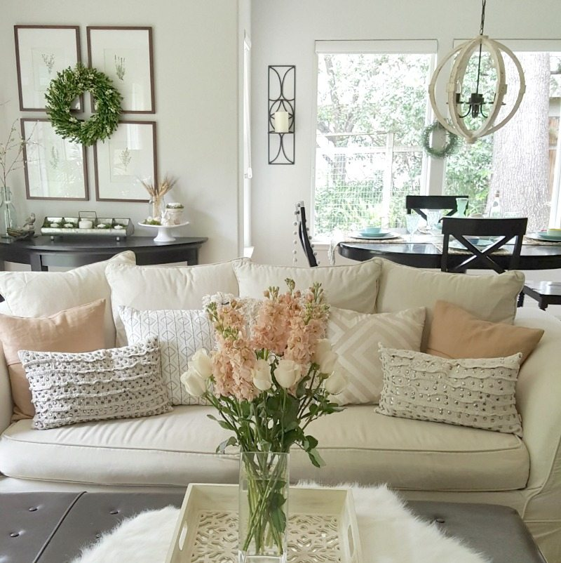Neutral decor can still be wow. We love to add fresh flowers to keep even a casual room feeling elegant.
