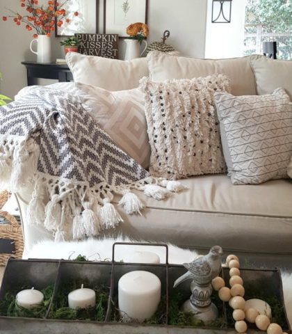 fall couch with textured pillows and throw