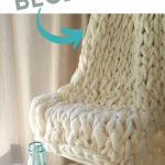 cream arm knit blanket draped over chair