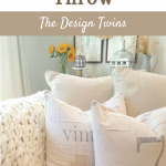 white chunky knit throw on cream colored couch with pillows