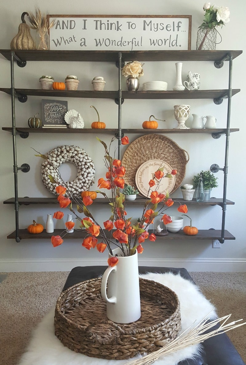 Pumpkins and orange to decorate pipe shelves for fall