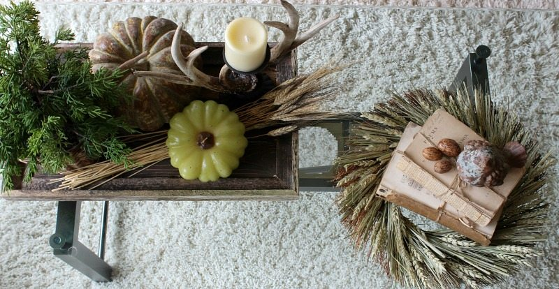 Coffee table fall theme with natural elements from above
