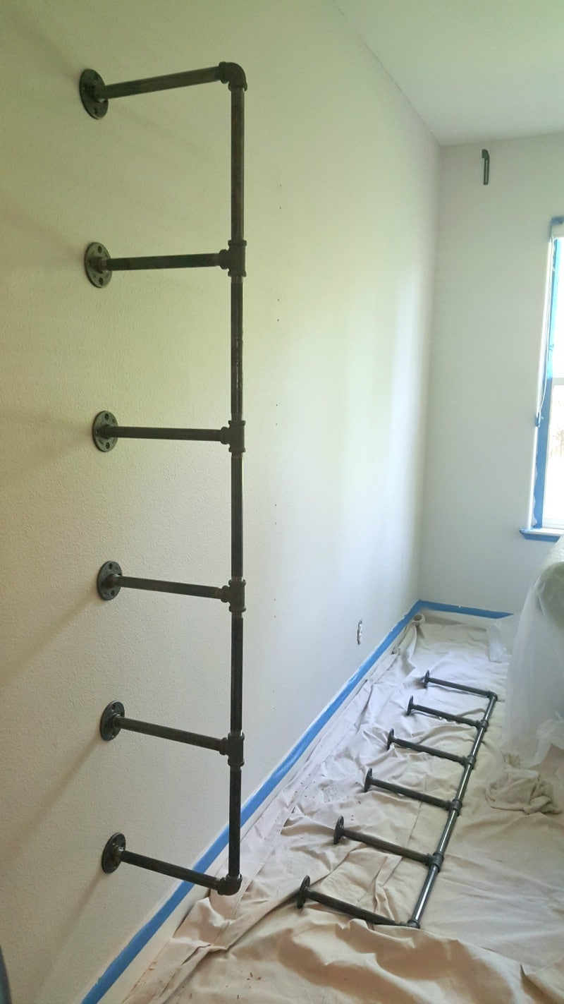 installation process attaching wall brackets for diy pipe shelves