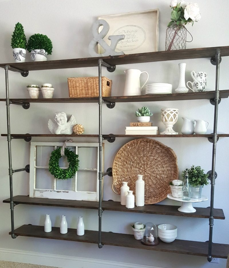 DIY industrial pipe shelves create pretty pictures