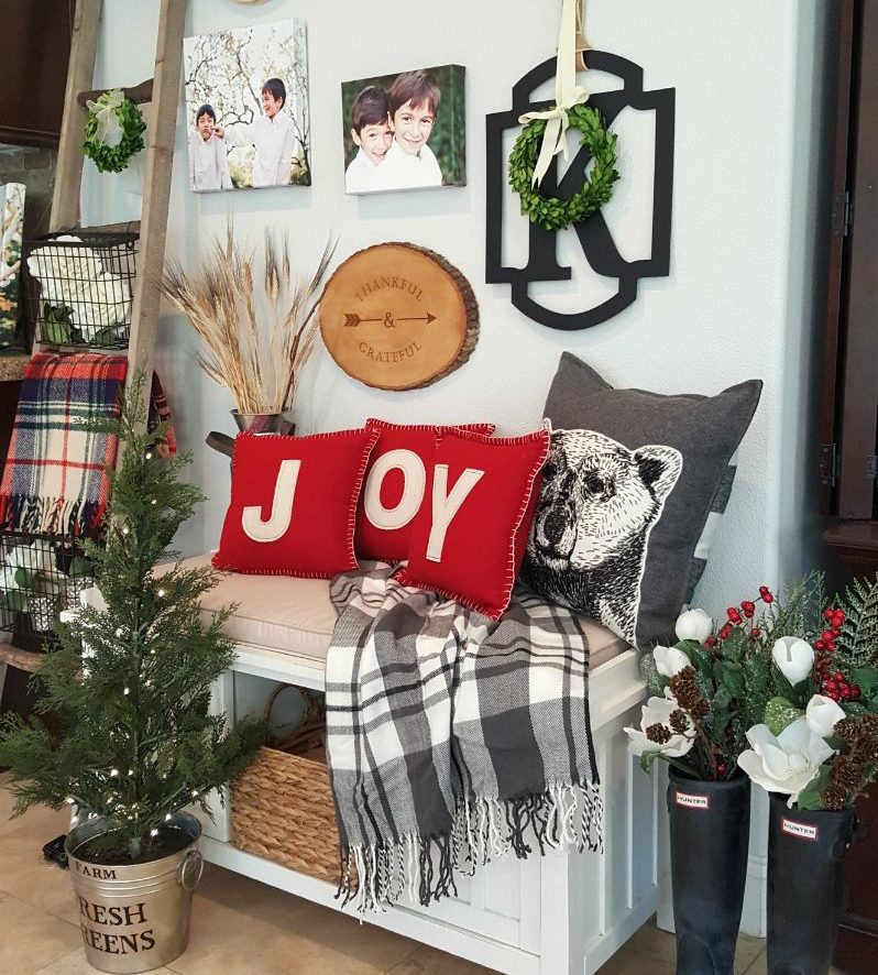 inspired Christmas decor with plaid throws and joy pillows