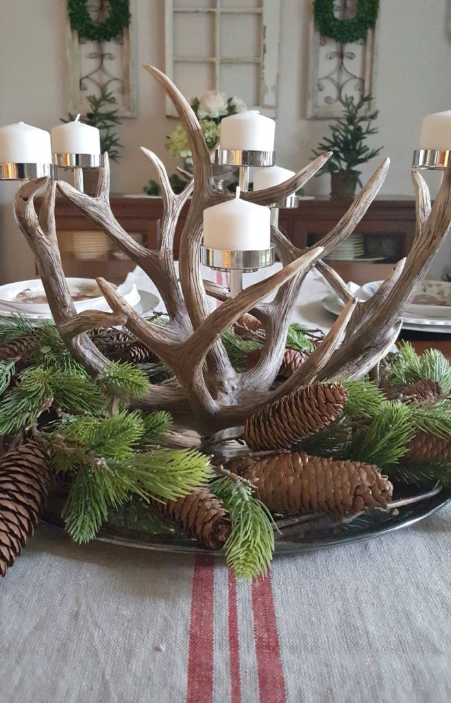 An antler candelabrum is the perfect rustic centerpiece for this natural inspired Christmas decor