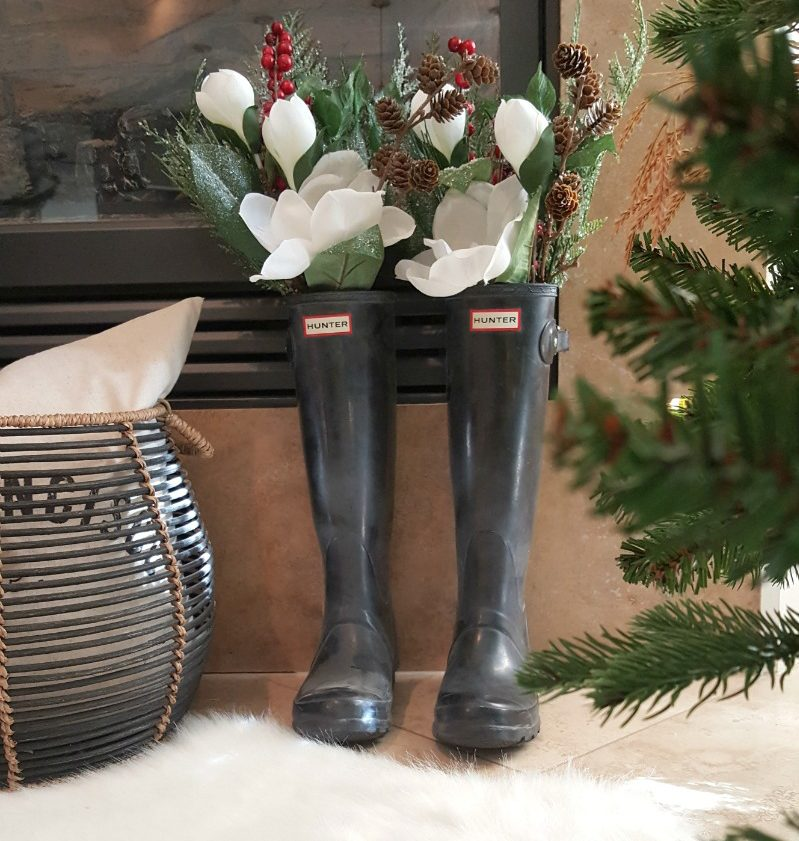 Holiday botanicals, magnolias and berries, pinecones and evergreens are beautiful, natural decor and rainboots as decor