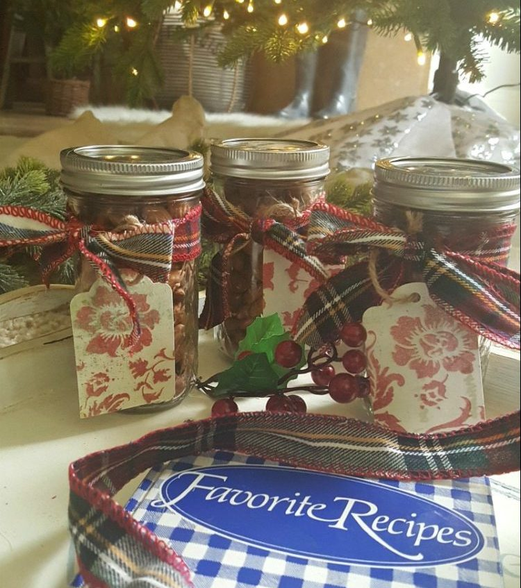 Mason jars filled with homemade ginger spiced nuts tied with plaid bows
