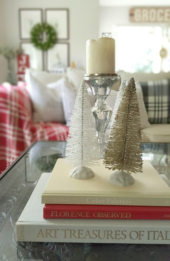 essential decor elements with books and mini trees and candle holders