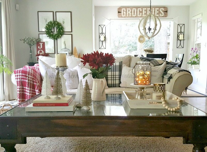 Whites, sparkle and a pop of red brighten up a holiday coffee table using the right mix of essential decor elements.
