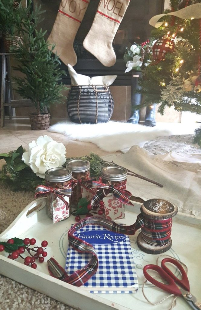 mason jars tied with plaid flannel ribbon and gift cards are perfect holiday gifts
