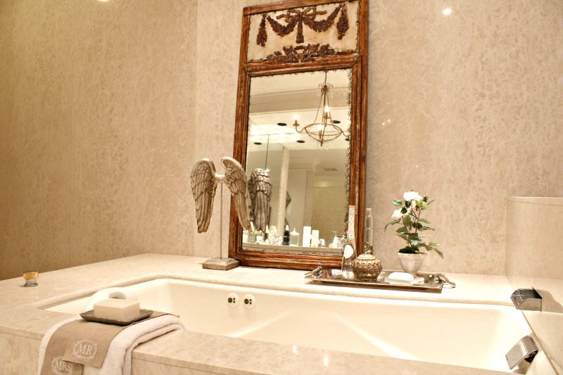 Custom marble bathroom with mirror and stunning luxury details in this relaxing bathroom retreat