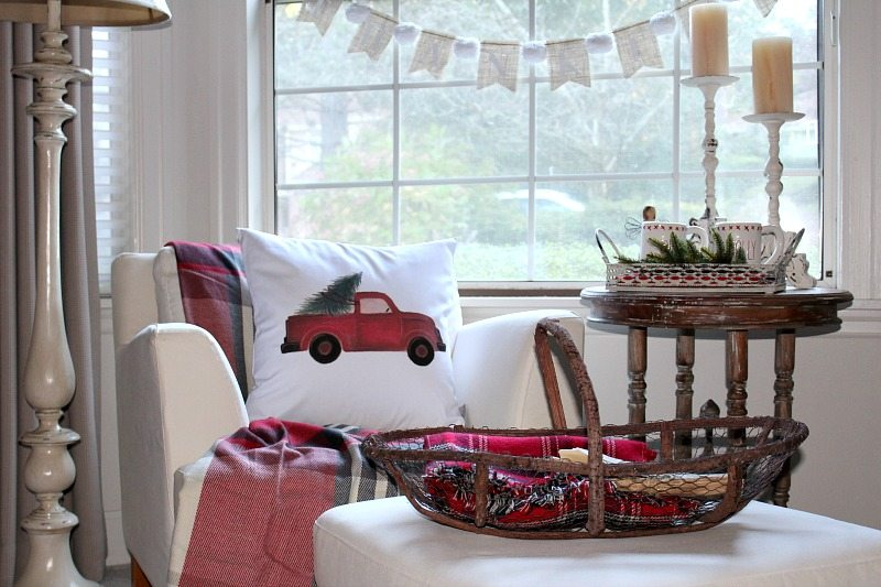 Master bedroom decor is holiday ready with traditional reds, pillows and tartan