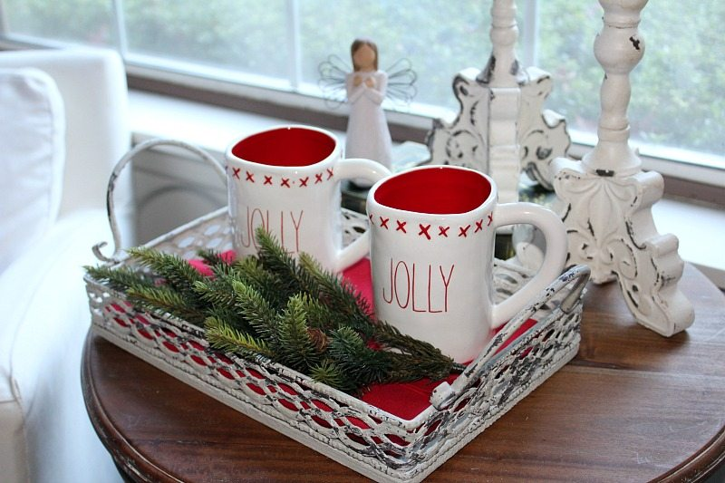 Holiday cozy bedroom vignette with holiday mugs and angel