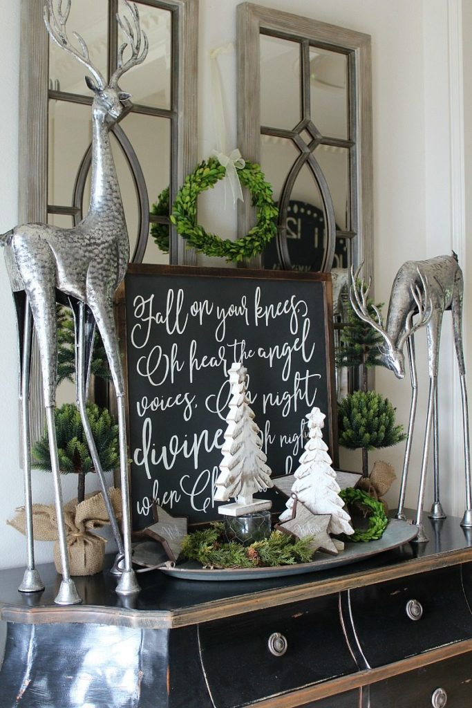 Holiday Decorating: Home Tour with festive farmhouse sign with wooden trees and metal deer for creative vignette