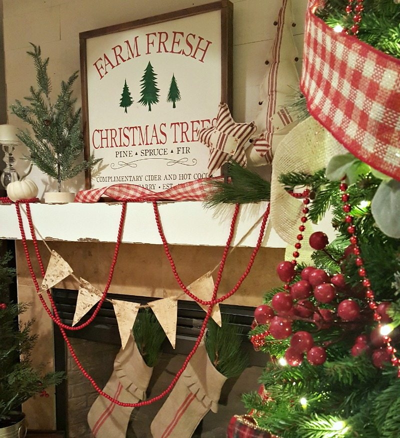 traditional fireplace inspiring Christmas decor with garlands and stockings