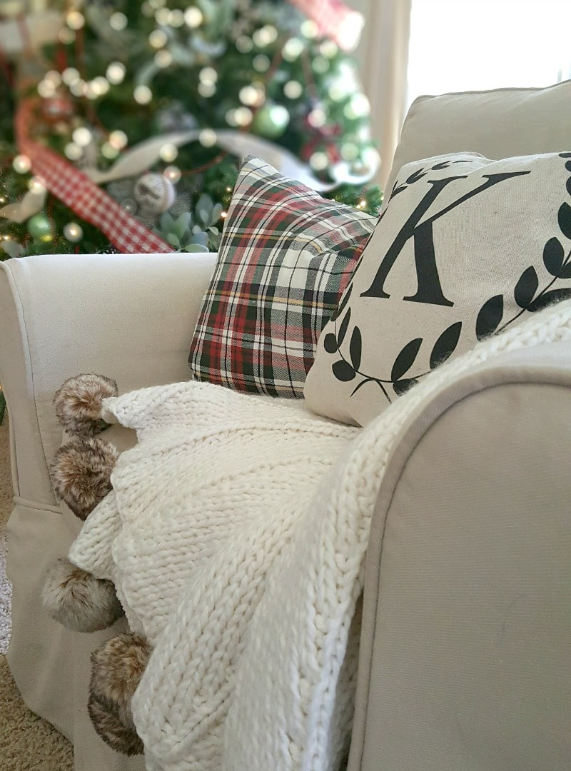 Christmas pillows and pompom throw with xmas tree