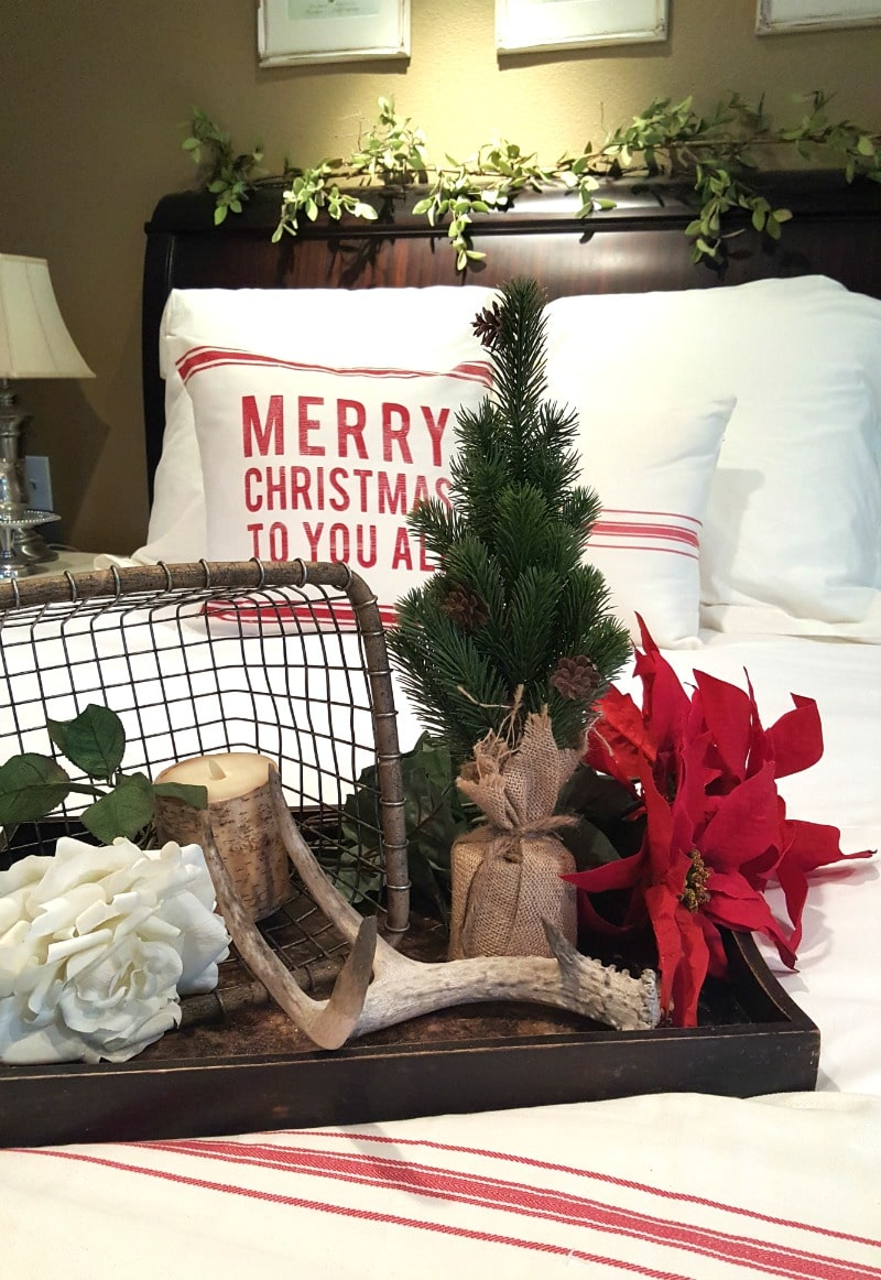 holiday bedroom decor with evergreen and rustic details
