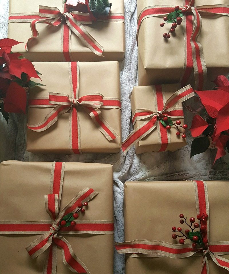 brown paper packages with red ribbon and holly