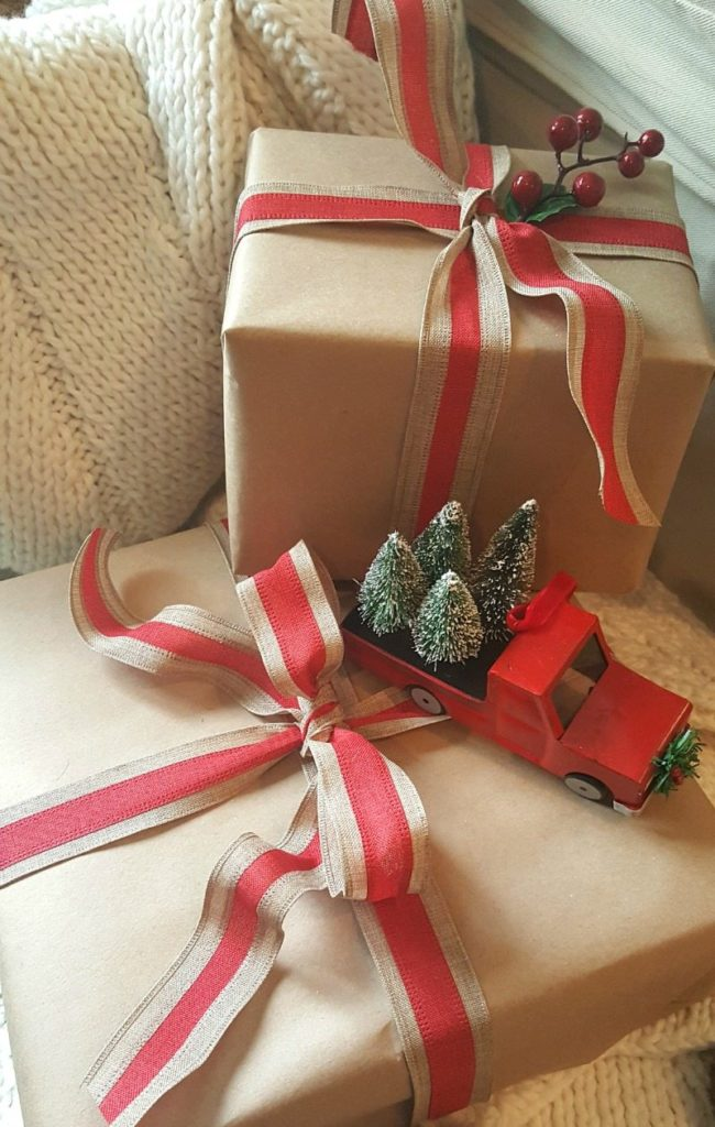 brown paper packages with red truck and trees