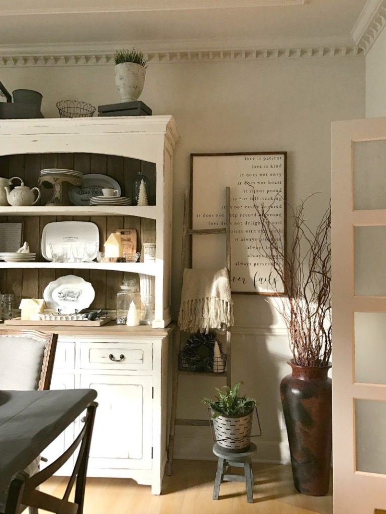 farmhouse hutch layered with handmade sign, vintage ladder details