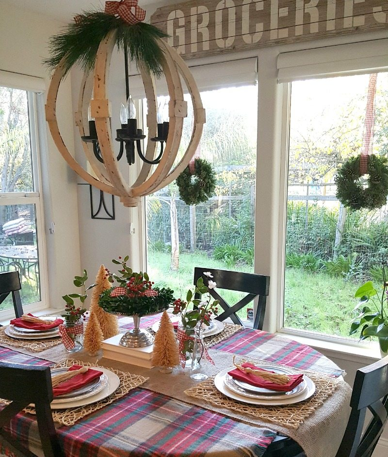 Festive Christmas table decor with rustic chandelier