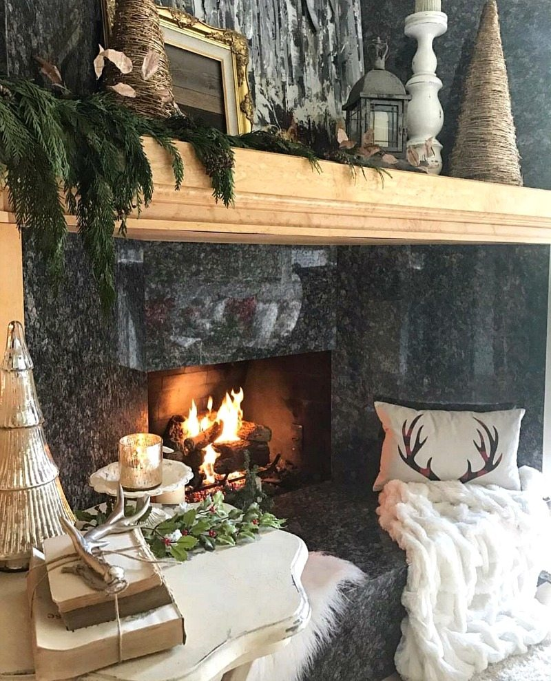cozy warm inviting fireplace with pillows and throw