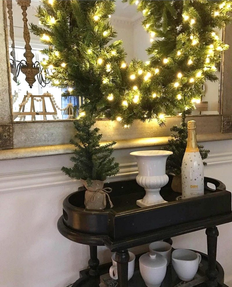 Holiday party isn't complete without festive bar cart and twinkling wreath