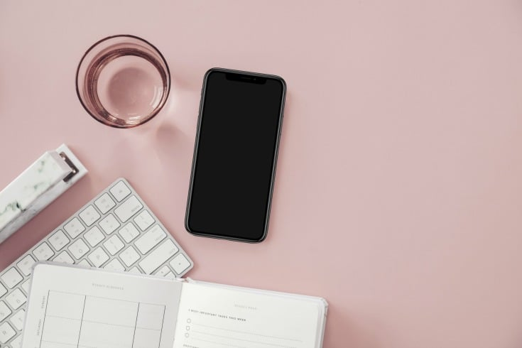 pink backdrop with smart phone grow Instagram following