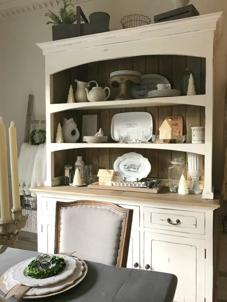 vintage plates, ironstone and antiques decorate farmhouse hutch