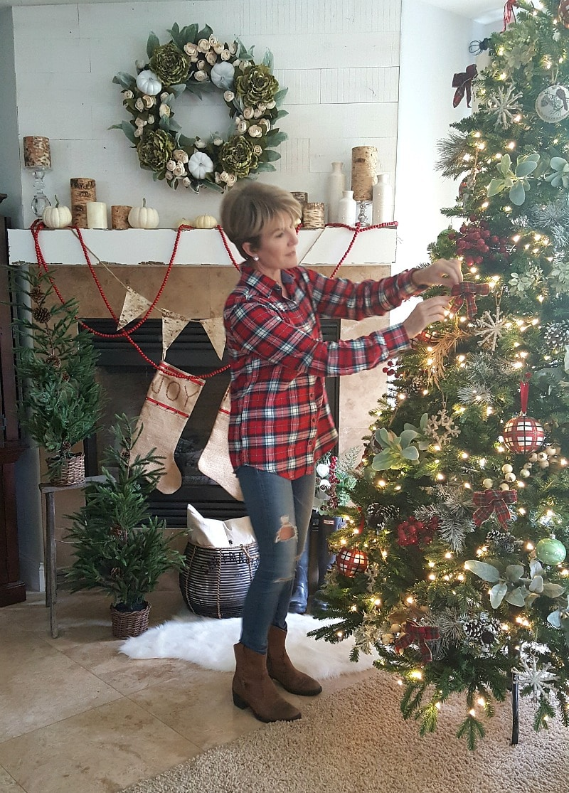 traditional rustic inspired Christmas decor Jodie decorating the tree