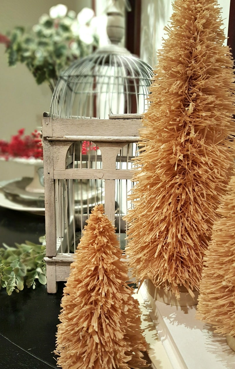 unique inspiring Christmas decor with bird cage and mini trees
