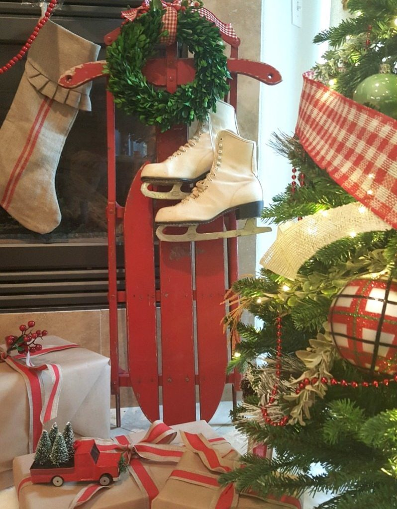 antique red chippy sled and white vintage ice skates add vintage charm