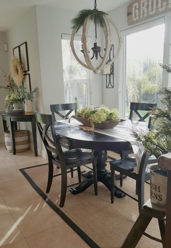 Kitchen Refresh using florals in a doughbowl and rustic chandelier