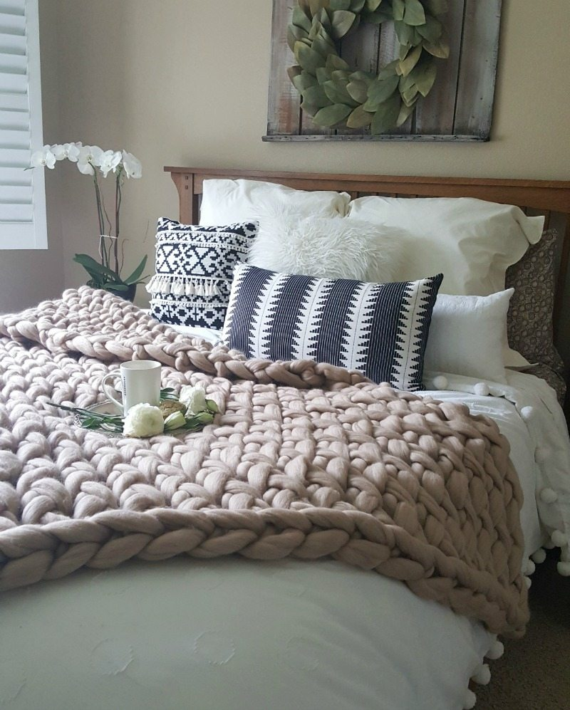 guest bed with pompoms