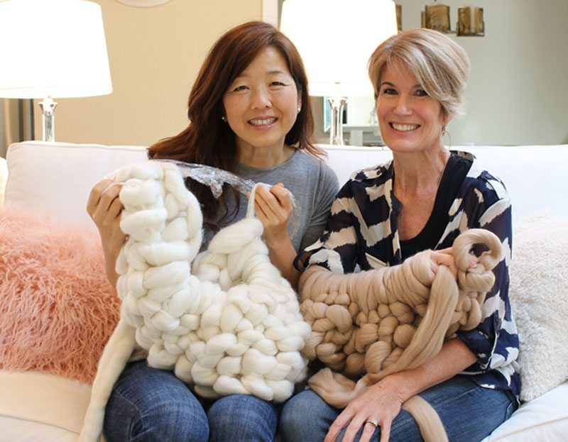 The Design Twins arm knitting project will help you create your own chunky knit blanket!