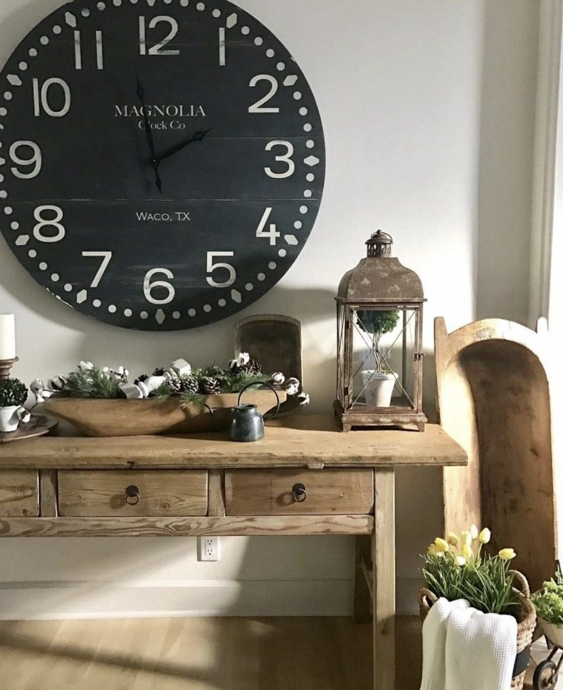 magnolia clock above farmhouse table entryway decorating ideas