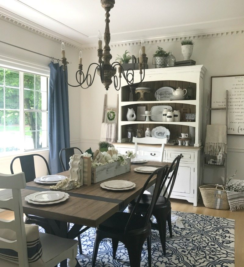 Farmhouse Dining room with farmhouse table and chandelier