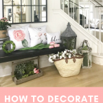 farmhouse decor front entryway with bench, floral pillows and greenery