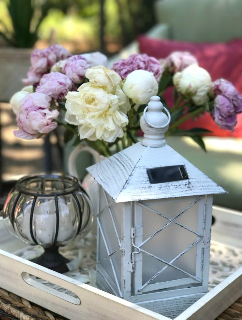 Outdoor flowers and lantern decor