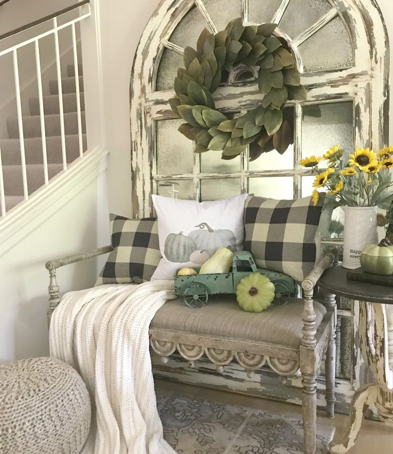 seasonally decorate with new pillows and cozy seating
