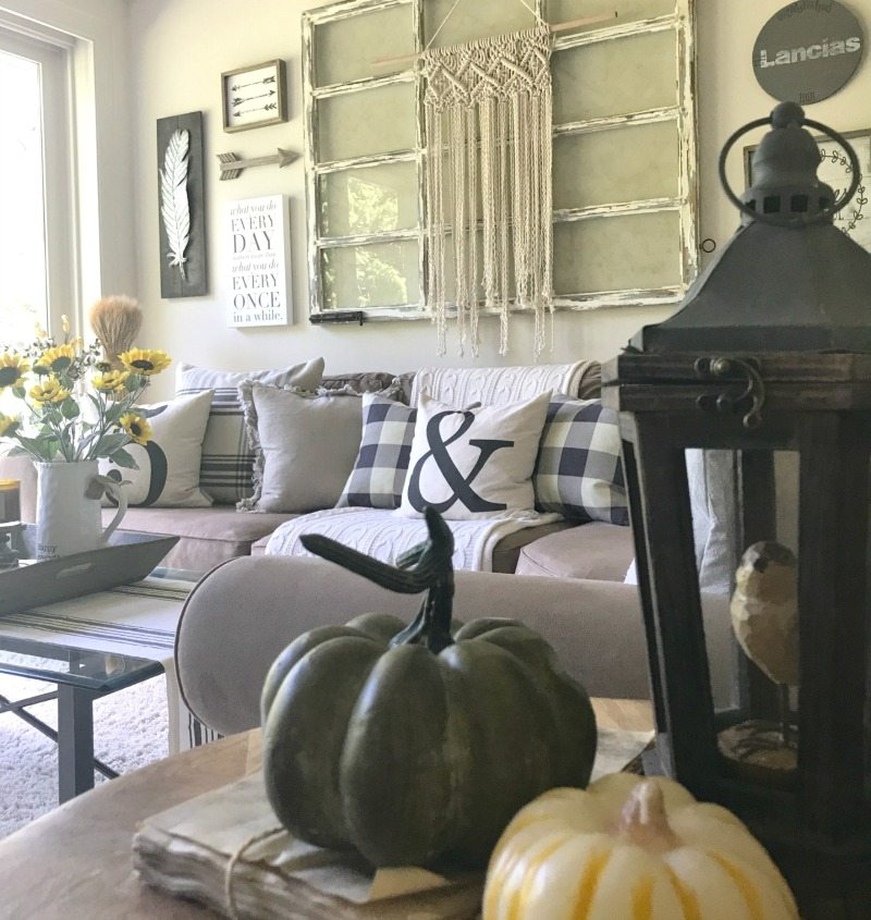 decorate for fall with neutrals and pumpkins in your family room