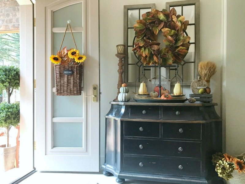 decorate for fall in your front entryway with sunflower door baskets and wreaths