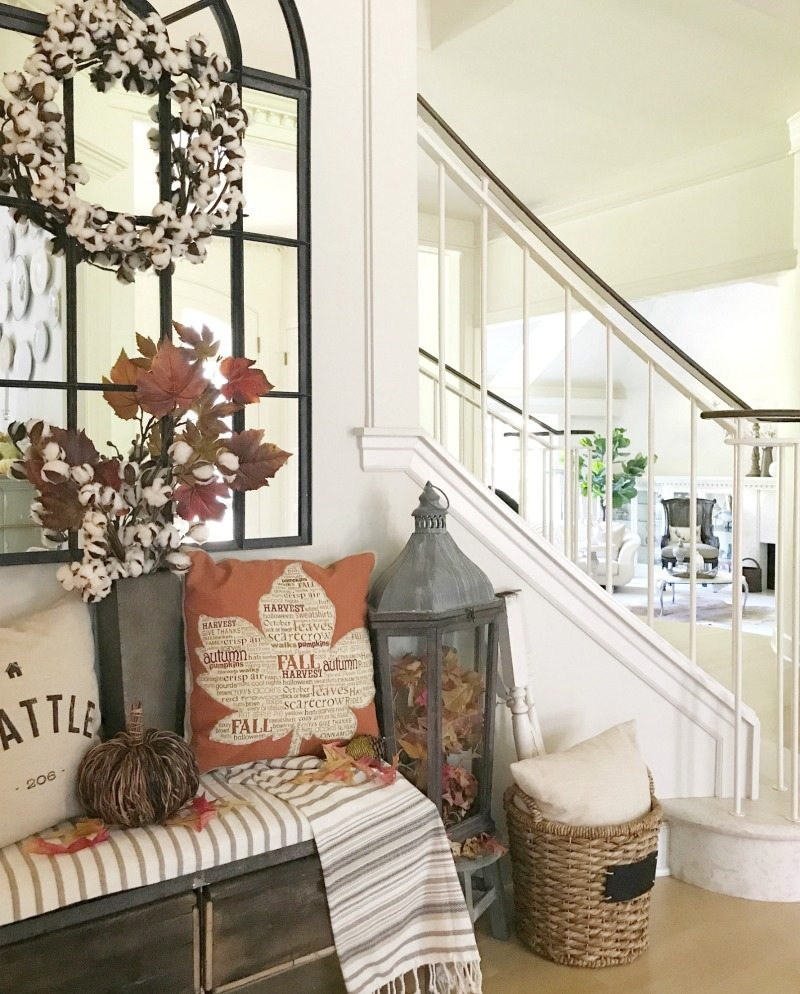 Fall Decorating with pillows wreaths and warm colors on bench