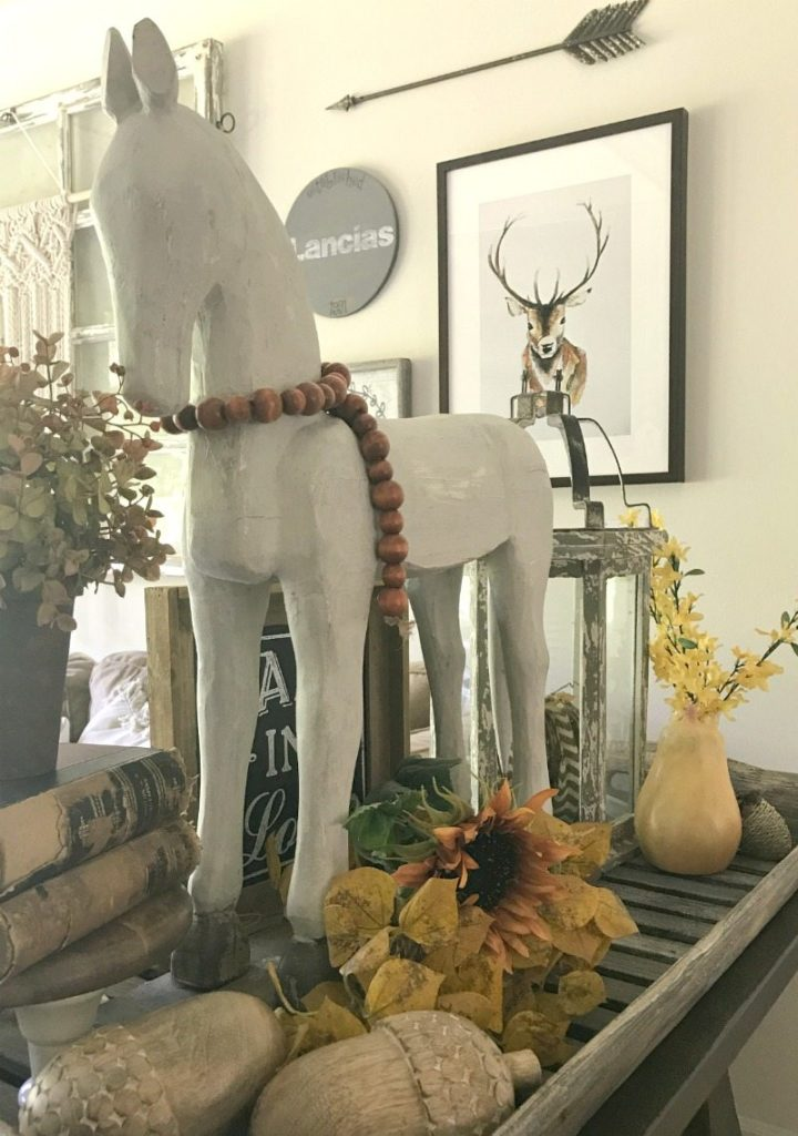 decorate for fall with a woodern horse