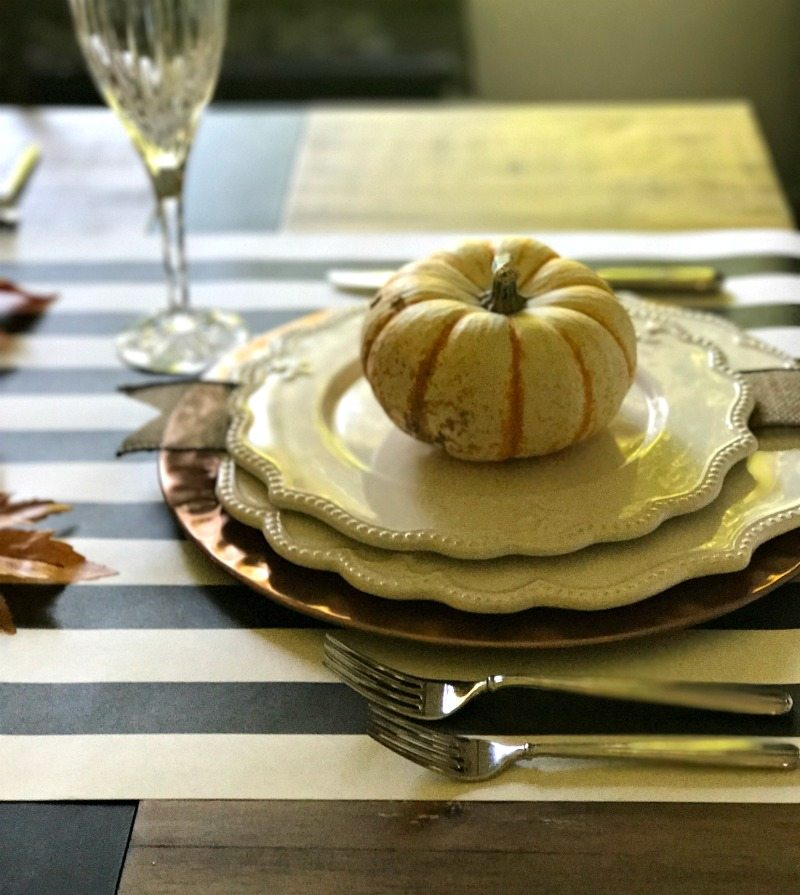 table setting with pumpkin