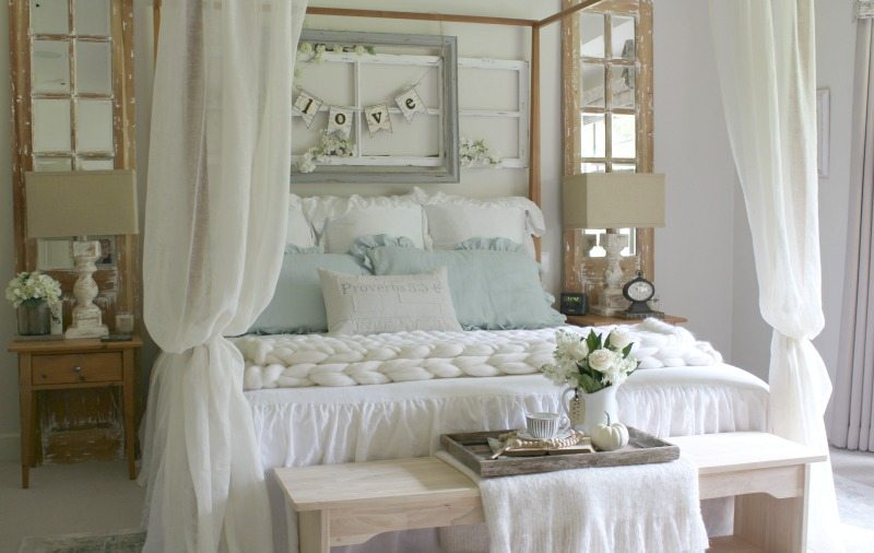 romantic master bedroom with white bedding