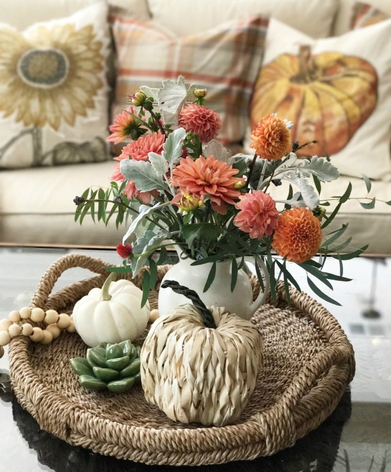 warm floral colors and festive pillows and pumpkins
