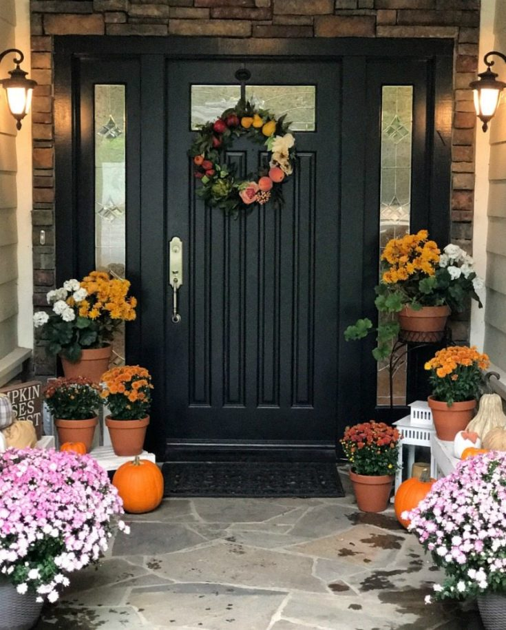 Fall porch decorated with mums and seasonal color for fall