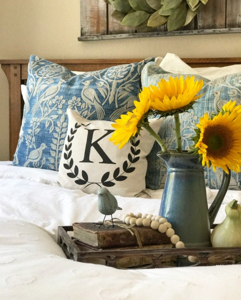 sunflowers and tray on bed